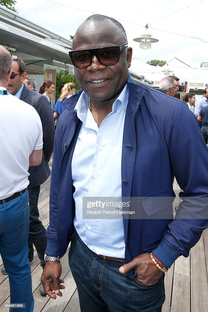 Footballer basile Boli attends the 2016 French Tennis Open - Day Six at Roland Garros on May 27, 2016 in Paris, France.