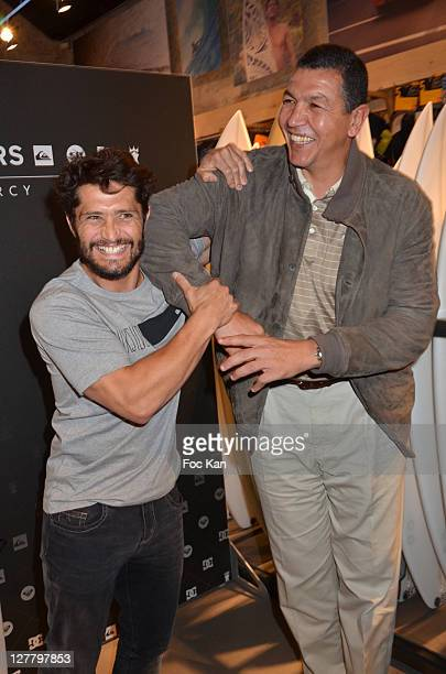 Footballer Bixente Lizarazu and rugbyman Abdelatif Benazzi attend the Quiksilver Flagship Inauguration At Bercy Village on May 10 2011 in Paris France