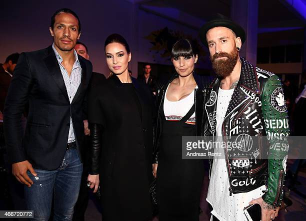 Footballer Bruno Alves guest footballer Raul Meireles and Ivone Meireles pose prior the Hakan Akkaya show during Mercedes Benz Fashion Week Istanbul...