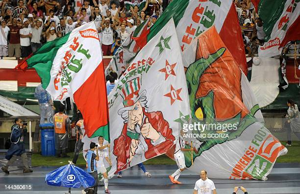Footballer Carlinhos of Fluminense carries a flag from supporters as the team celebrates the obtention of the Carioca Championship the football...