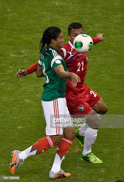 Footballer Carlos Pena of Mexico vies for the ball with Amilcar Henriquez of Panama during their Brazil 2014 FIFA World Cup CONCACAF qualifier match...