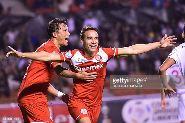 Footballer Carlos Rodriguez of Mexico's team Toluca celebrates after scoring against Ecuador's Liga de Quito during their Libertadores Cup match at...