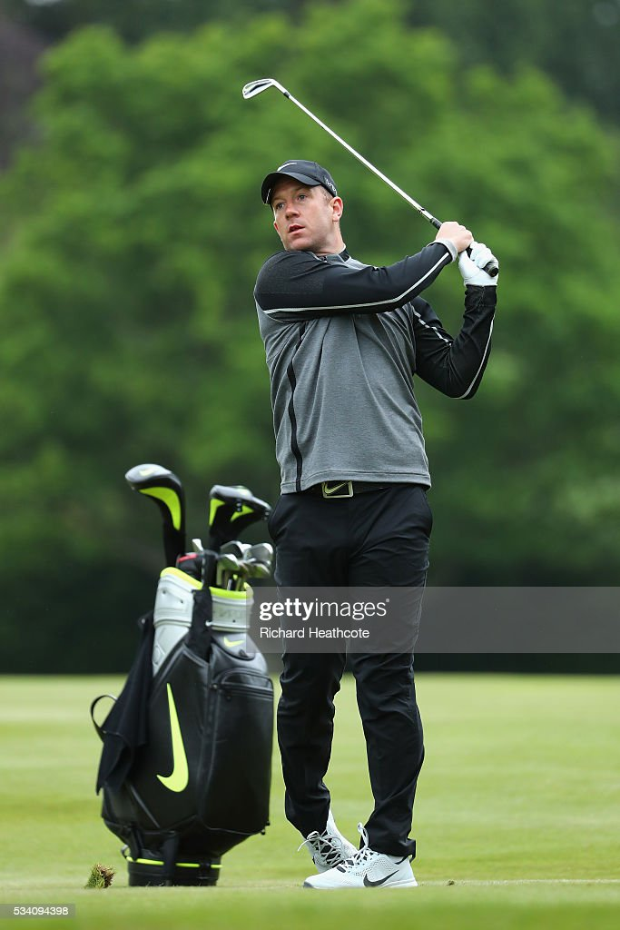Footballer <a gi-track='captionPersonalityLinkClicked' href=/galleries/search?phrase=Charlie+Adam&family=editorial&specificpeople=3987843 ng-click='$event.stopPropagation()'>Charlie Adam</a> hits an approach during the Pro-Am prior to the BMW PGA Championship at Wentworth on May 25, 2016 in Virginia Water, England.