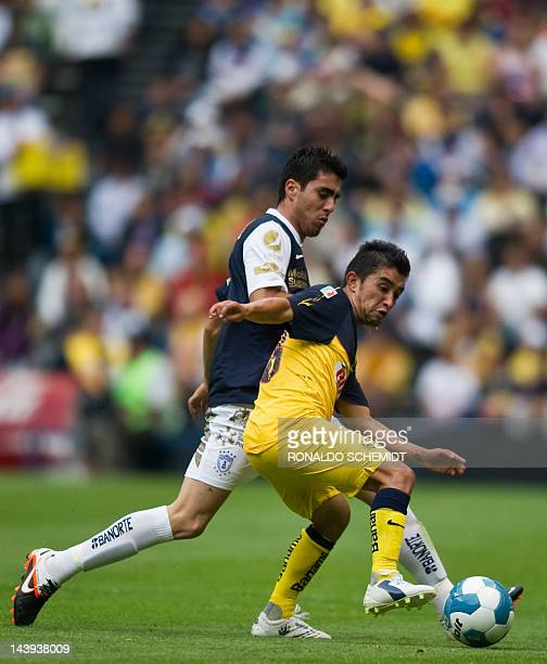 Footballer Christian Bermudez of America vies for the ball with Leobardo Lopez of Pachuca during the Mexican Clausura tournament in Mexico City on...