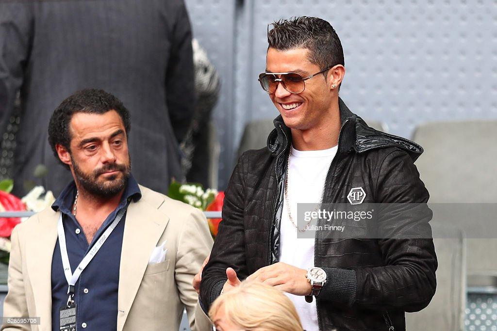 Footballer <a gi-track='captionPersonalityLinkClicked' href=/galleries/search?phrase=Cristiano+Ronaldo+-+Soccer+Player&family=editorial&specificpeople=162689 ng-click='$event.stopPropagation()'>Cristiano Ronaldo</a> attends the Men's Singles Quarter Final match between Rafael Nadal of Spain and Joao Sousa of Portugal during day seven of the Mutua Madrid Open at La Caja Magica on May 6, 2016 in Madrid, Spain.