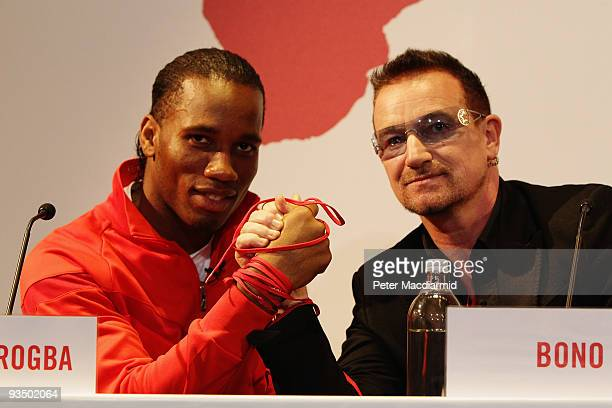 Footballer Didier Drogba and musician Bono attends the NIKE Charity Announcement at NikeTown on November 30 2009 in London England On the day before...
