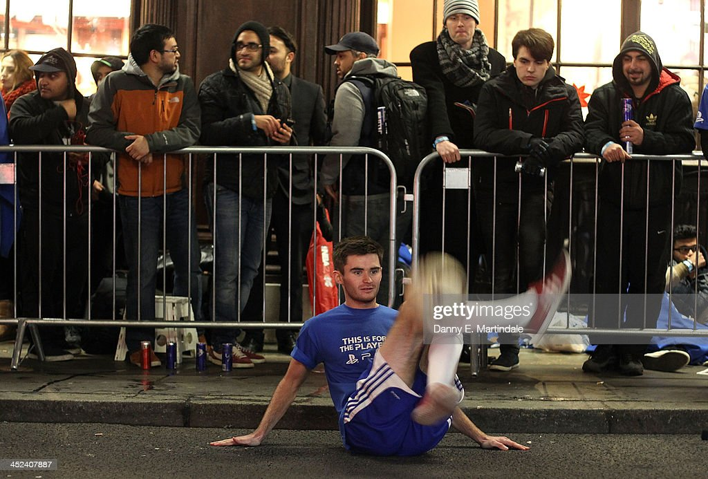 A footballer entertains the queue of gaming fans in Covent Garden ahead of the launch of the Playstation 4 on November 28, 2013 in London, England. PS4 consoles go on sale at midnight.
