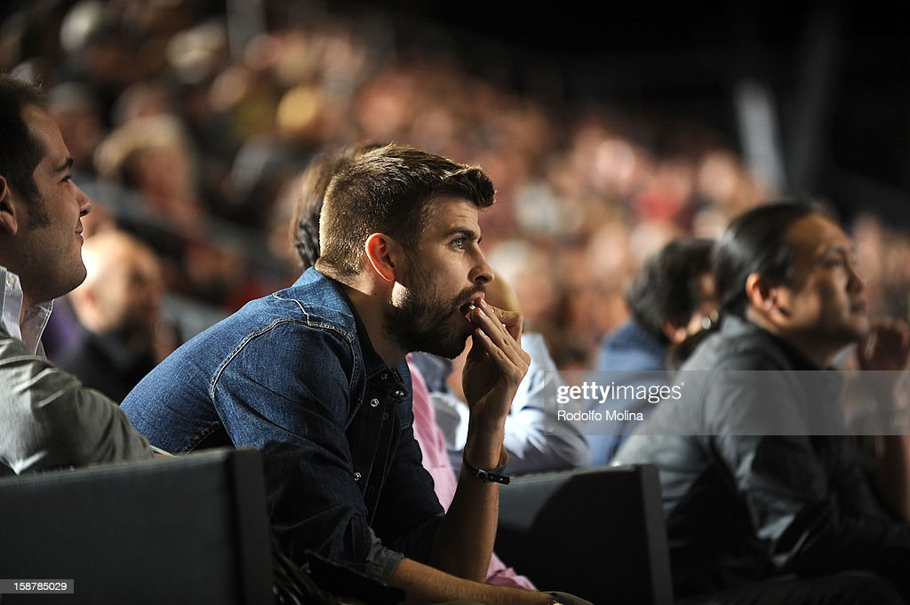 Footballer Gerard Pique of FC Barcelona watches the action from the stands during the 2012-2013 Turkish Airlines Euroleague Top 16 Date 1 between FC Barcelona Regal v Fenerbahce Ulker Istanbul at Palau Blaugrana on December 28, 2012 in Barcelona, Spain.