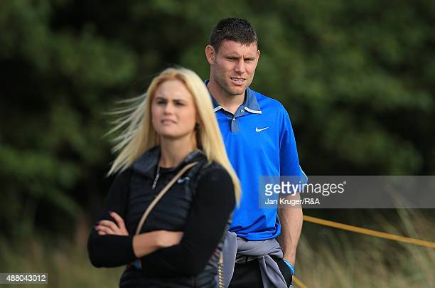 Footballer James Milner and LET Golfer Carly Booth of Scotland watch the action during the Sunday Singles on Day Two of the 2015 Walker Cup at Royal...