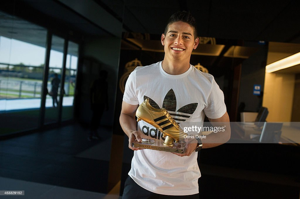 Footballer <a gi-track='captionPersonalityLinkClicked' href=/galleries/search?phrase=James+Rodriguez&family=editorial&specificpeople=4422074 ng-click='$event.stopPropagation()'>James Rodriguez</a> receives his adidas Golden Boot Trophy at Real Madrid's Valdebebas in recognition of scoring the most goals during the 2014 FIFA World Cup on August 7, 2014 in Madrid, Spain.