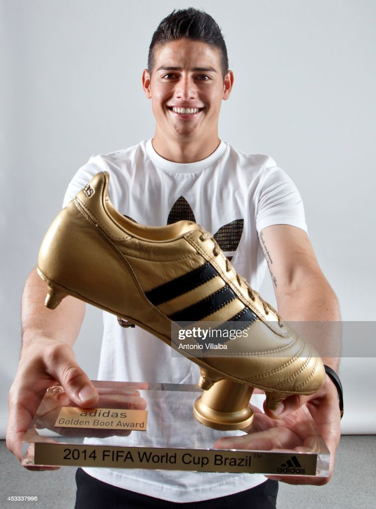 Footballer <a gi-track='captionPersonalityLinkClicked' href=/galleries/search?phrase=James+Rodriguez&family=editorial&specificpeople=4422074 ng-click='$event.stopPropagation()'>James Rodriguez</a> receives his adidas Golden Boot Trophy at Real Madrid's Valdebebas in recognition of scoring the most goals during the 2014 FIFA World Cup on August 8, 2014 in Madrid, Spain.