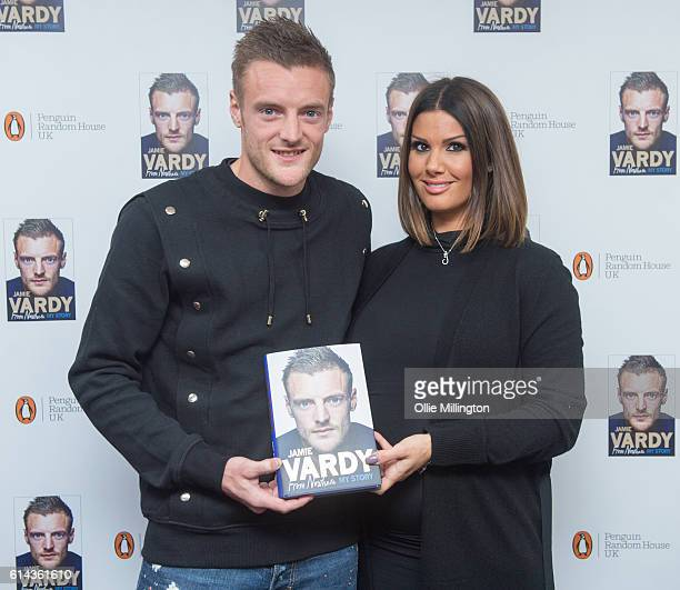 Footballer Jamie Vardy poses with his wife Rebekah Vardy before meeting fans and signing copies of his new book 'From Nowhere My Story' on October 13...