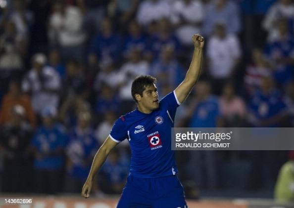 Footballer Javier Orozco of Mexican team Cruz Azul celebrates after scoring against Libertad of Paraguay during a Libertadores Cup football match...