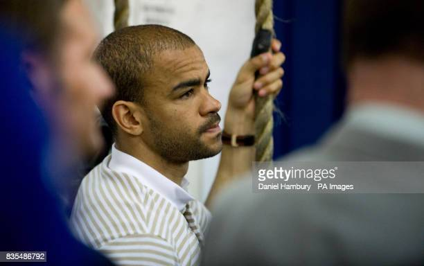 Footballer Kieron Dyer watches Floyd Mayweather Jnr during the media work out at the Peacock Gym London