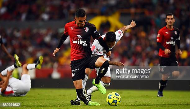 Footballer Luis Reyes of Atlas vies for the ball with Raul Ruidiaz of Morelia during their Mexican Clausura 2017 tournament football match at Jalisco...