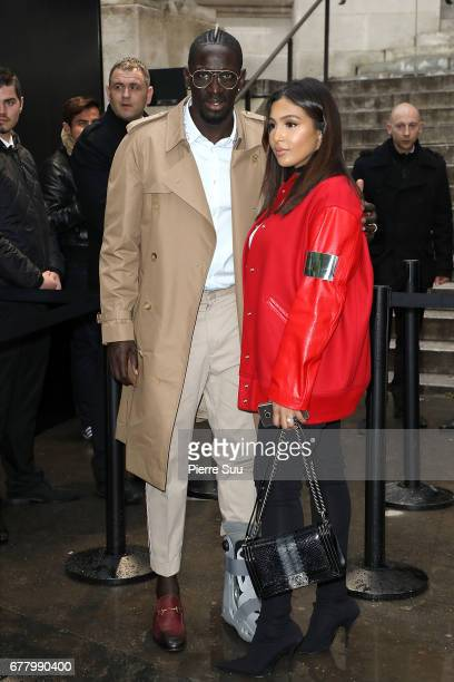 Footballer Mamadou Sakho and his wife Majda arrives at the Chanel Cruise 2017/2018 Collection at Grand Palais on May 3 2017 in Paris France