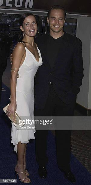 Footballer Mark Bosnich and Girlfriend/Model Sophie Anderton arrive at the London Premiere for Star Wars Episode 2 Attack of the Clones at the Odeon...