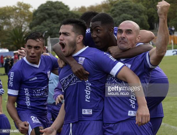 Footballer Maximiliano Gomez of Defensor celebrates after scoring against Fenix during a Uruguayan Apertura football tournament match in Montevideo...