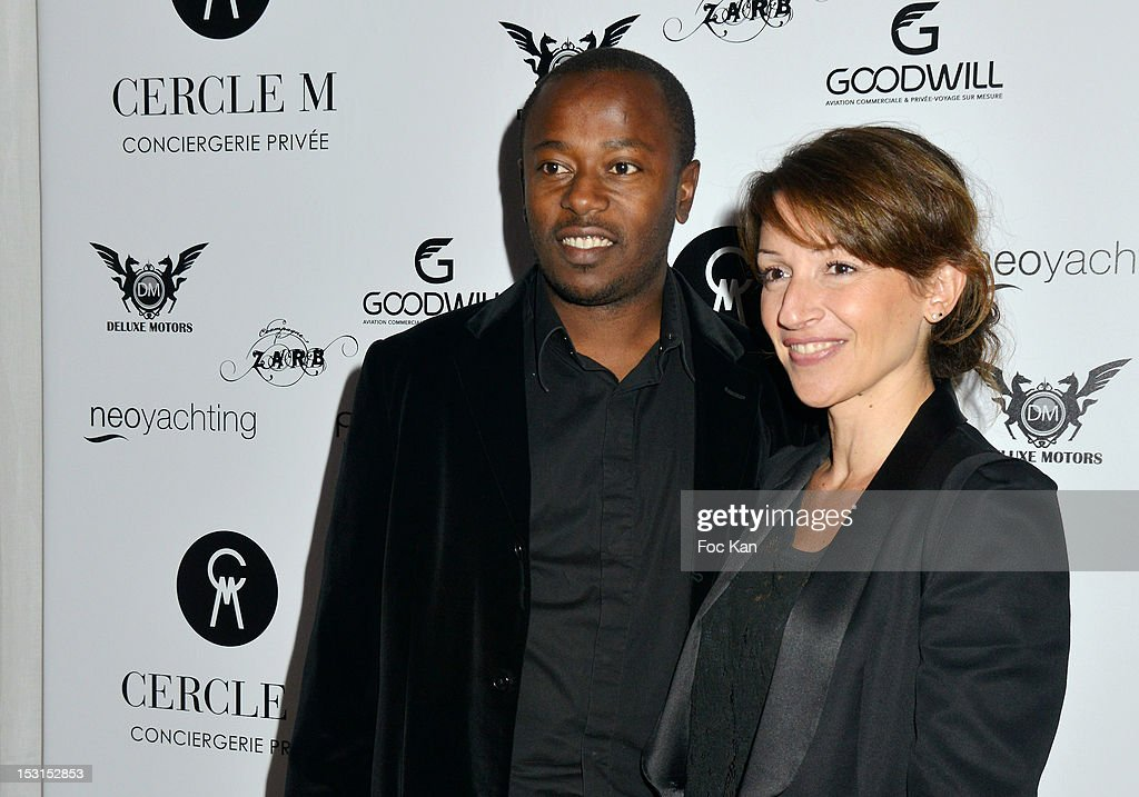 Footballer Momo Sissoko (L) and his wife pose during the 'Cercle M' Launch Party at La Cantine du Faubourg on September 30, 2012 in Paris, France.