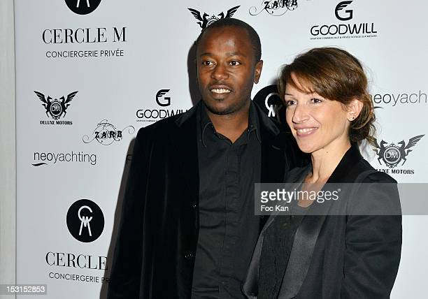 Footballer Momo Sissoko and his wife pose during the 'Cercle M' Launch Party at La Cantine du Faubourg on September 30 2012 in Paris France