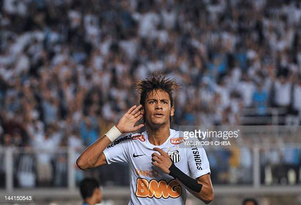 Footballer Neymar of Brazilian team Santos celebrates after scoring against Bolivia's Bolivar during a Libertadores Cup match at Vila Belmiro stadium...