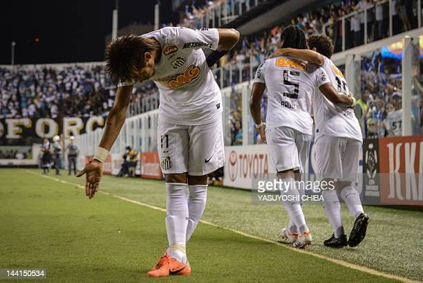 Footballer Neymar of Brazilian team Santos makes a bow to the fans after scoring against Bolivia's Bolivar during a Libertadores Cup match at Vila...