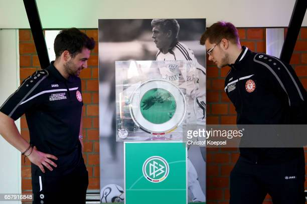 Footballer of Fortuna Koeln watch the DFB C Juniors Cup trophy during the B and C Juniors German Indoor Football Championship at Sporthalle West on...