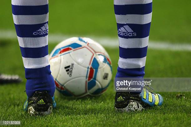 A footballer of Schalke and the football is seen during the UEFA Europa League playoff second leg match between FC Schalke and HJK Helsinki at...