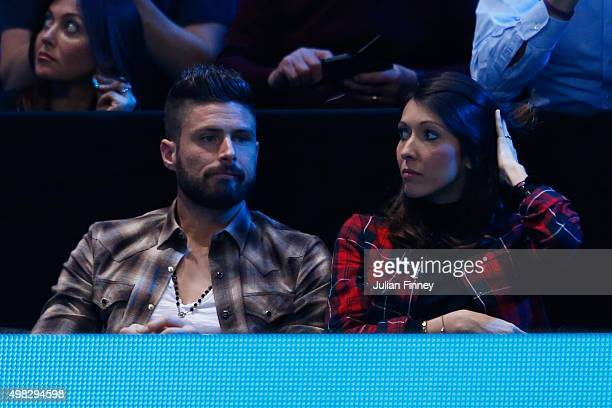 Footballer Olivier Giroud of Arsenal and France and his wife Jennifer attend the men's singles final between Roger Federer of Switzerland and Novak...