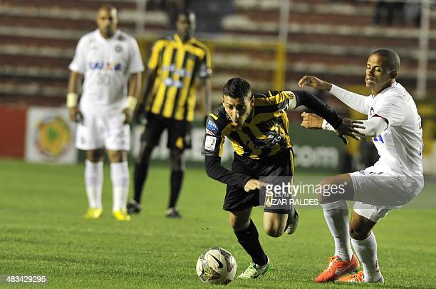 Footballer Pablo Escobar of Bolivia's The Strongest vies for the ball with Cleberson of Brazilian Paranaense during their Copa Libertadores match at...