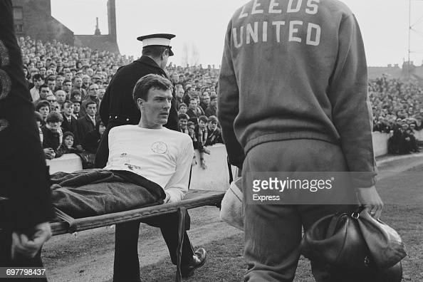 Footballer Paul Madeley of Leeds United is carried off after an injury during a League Division One match against Nottingham Forest UK 19th February...