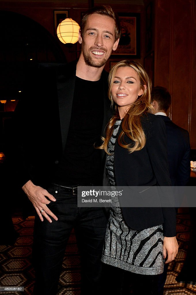 Footballer <a gi-track='captionPersonalityLinkClicked' href=/galleries/search?phrase=Peter+Crouch&family=editorial&specificpeople=210764 ng-click='$event.stopPropagation()'>Peter Crouch</a> and his wife model Abbey Clancy attend the LOVE x Balmain Xmas Party at The Ivy Market Grill on December 15, 2014 in London, England.