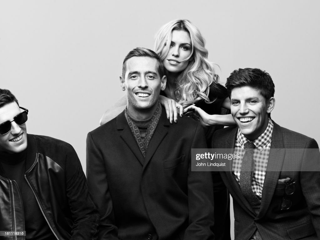 Footballer <a gi-track='captionPersonalityLinkClicked' href=/galleries/search?phrase=Peter+Crouch&family=editorial&specificpeople=210764 ng-click='$event.stopPropagation()'>Peter Crouch</a> with model Abbey Clancy and her brothers Sean and John Clancy are photographed for Mr Porter on October 28, 2011 in London, England.
