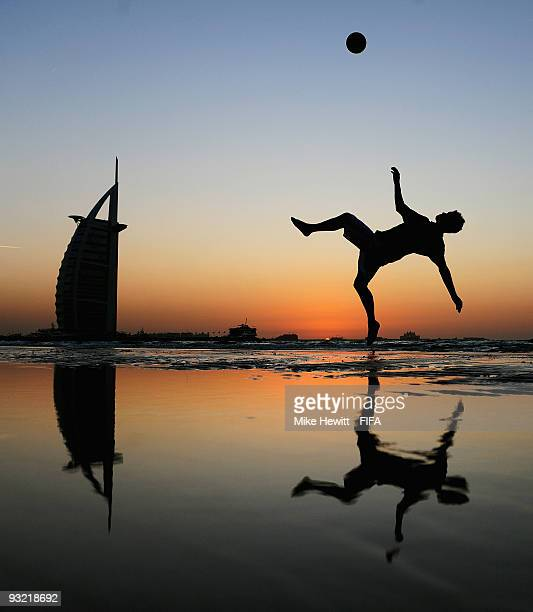 A footballer practices on the beach in front of the Burg Al Arab hotel during the rest day of the FIFA Beach Soccer World Cup on November 19 2009 in...
