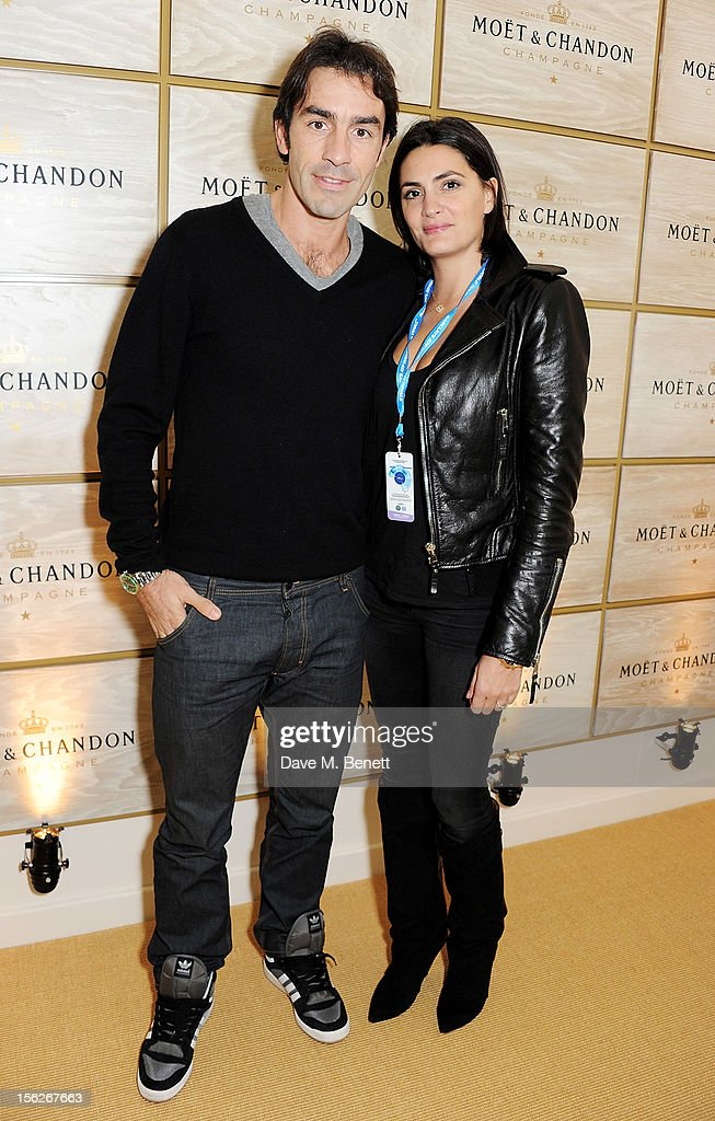 Footballer <a gi-track='captionPersonalityLinkClicked' href=/galleries/search?phrase=Robert+Pires&family=editorial&specificpeople=167225 ng-click='$event.stopPropagation()'>Robert Pires</a> (L) and wife Jessica Lemarie attend the Moet & Chandon VIP Suite during day eight of the ATP World Finals at the O2 Arena on November 12, 2012 in London, England.