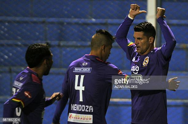 Footballer Ruben De la Cuesta of Real Potosi of Bolivia celebrates with teammates after scoring against U Catolica of Chile during a football match...