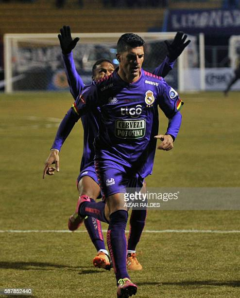 Footballer Ruben De la Cuesta of Real Potosi of Bolivia celebrates with teammates after scoring against U Catolica of Chile during their football...