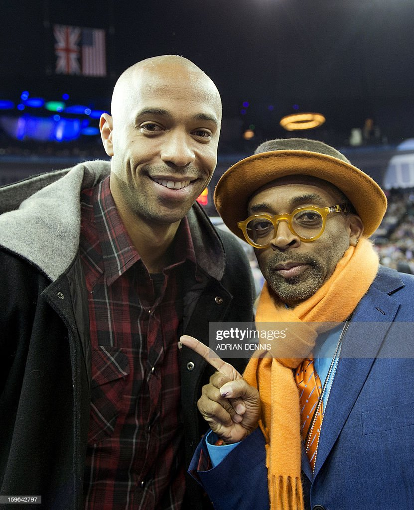 Footballer Thierry Henry (L) and film director Spike Lee (R) pose for a photograph ahead of the NBA basketball game between The New York Knicks and The Detroit Pistons at the O2 Arena in London on January 17, 2013.