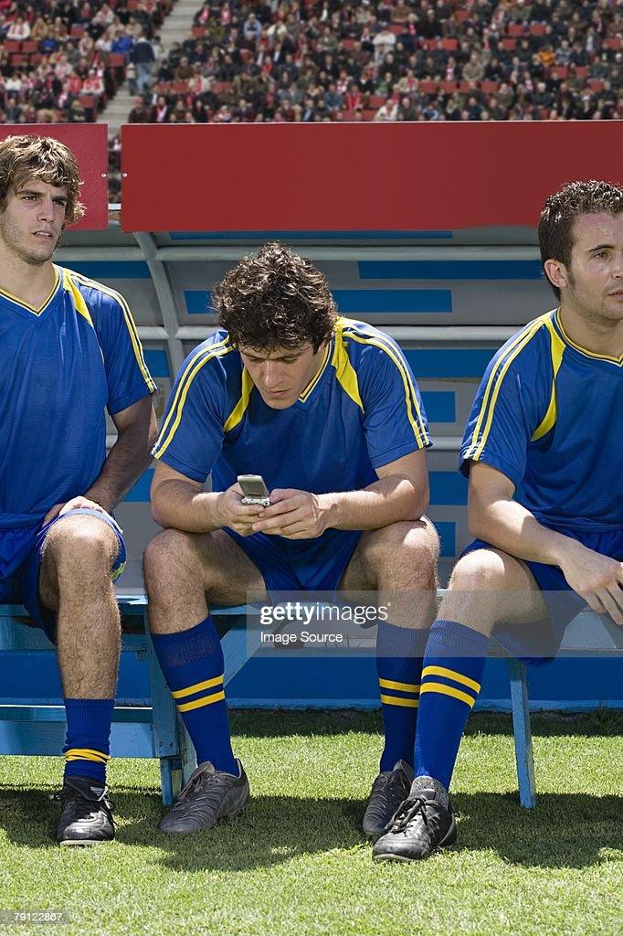 Footballer using cell phone