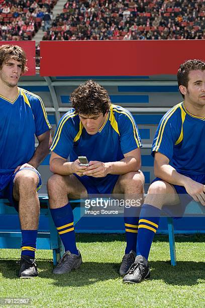 Footballer using cell phone