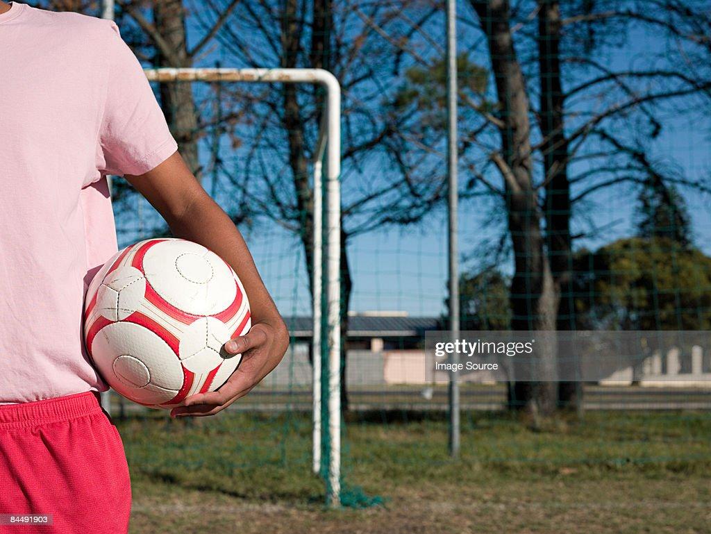 Footballer with a football : Stock Photo