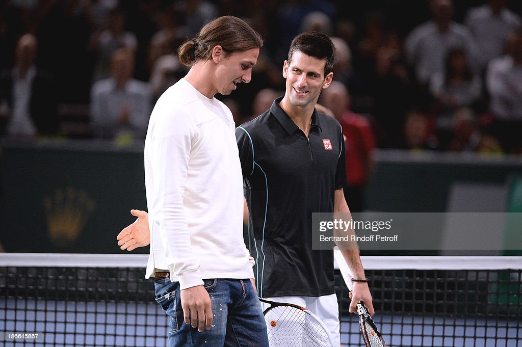 Footballer Zlatan Ibrahimovic shakes hands with Novak Djokovic of Serbia after the match against Roger Federer during day six of the BNP Paribas Tennis Masters, held at Bercy on November 2, 2013 in Paris, France.