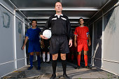 Footballers and referee in a tunnel