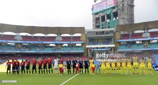 Footballers are seen during the ceremony within a 2017 FIFA U17 World Cup football match between Turkey U17 and Mali U17 in Mumbai India on October...