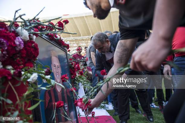Footballers attend a memorial ceremony held for Czech football player Frantisek Rajtoral who was found dead Sunday in his home in Gaziantep at a...