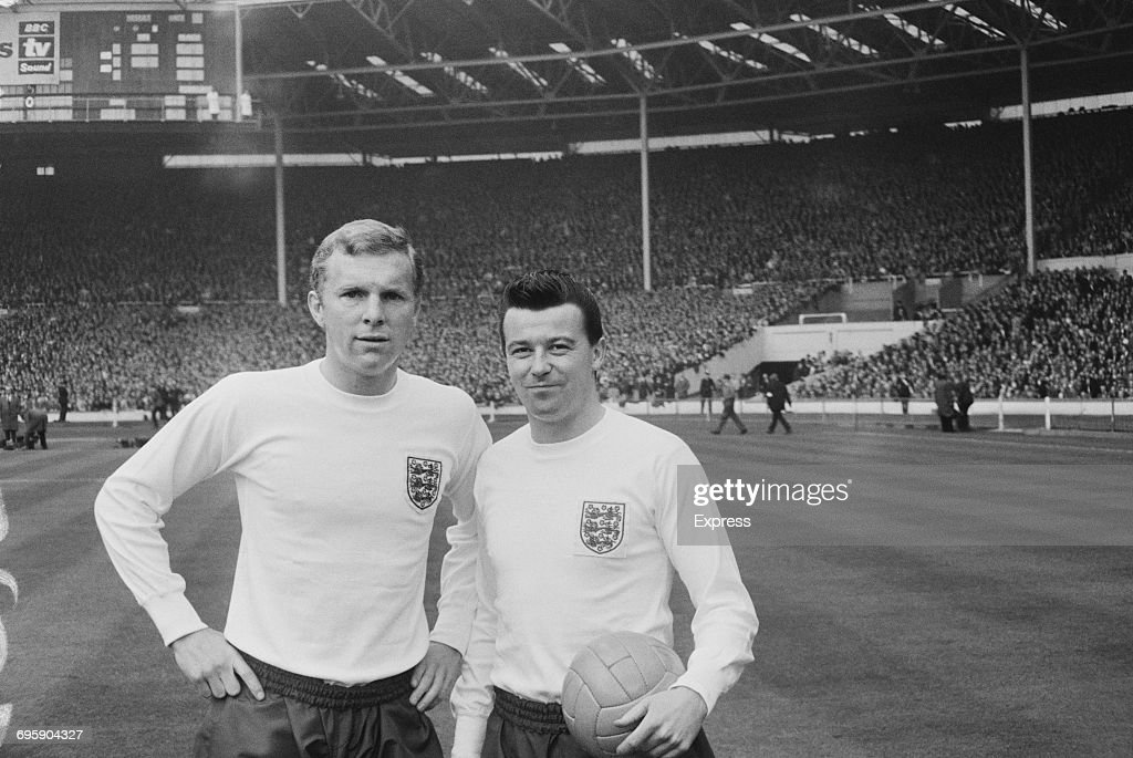 Footballers Bobby Moore (1941 - 1993, left) and Johnny Byrne (1939 - 1999) of West Ham United and the England team at Wembley Stadium, London, 12th April 1965.