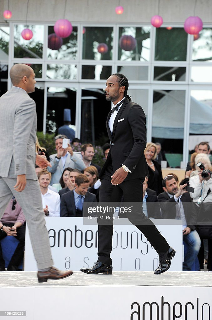 Footballers Damian Batt (L) and <a gi-track='captionPersonalityLinkClicked' href=/galleries/search?phrase=Cameron+Jerome&family=editorial&specificpeople=815275 ng-click='$event.stopPropagation()'>Cameron Jerome</a> walk the runway at Amber Lounge Fashion Monaco 2013 at Le Meridien Beach Plaza Hotel on May 24, 2013 in Monaco, Monaco.