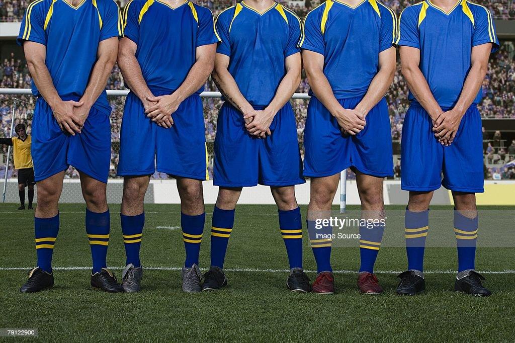 Footballers defending a free kick : Stock Photo