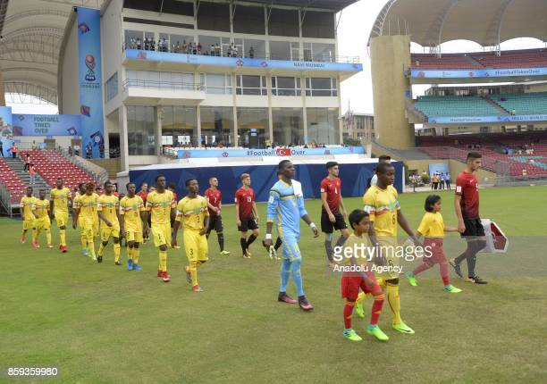 Footballers enter the field during a 2017 FIFA U17 World Cup football match between Turkey U17 and Mali U17 in Mumbai India on October 09 2017