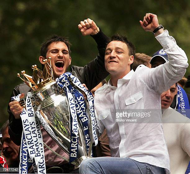 Footballers Frank Lampard and John Terry hold the FA Premiership Trophy during Chelsea Football Clubs parade May 22 2005 in London